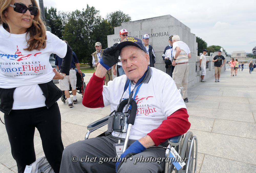 WASHINGTON, DC.  WWII Veterans and their escorts onboard the Hudson Valley Honor Flight at the World War II Memorial in Washington, DC on Saturday, September 21, 2013.  © www.chetgordon.com