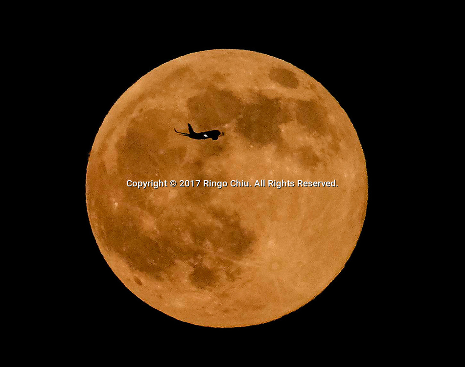 An airplane flies pass the full moon Saturday, July 8, 2017 in Los Angeles, California. . (Photo by Ringo Chiu)<br /> <br /> Usage Notes: This content is intended for editorial use only. For other uses, additional clearances may be required.