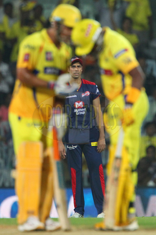 Ashish Nehra looks on as Dwayne Bravo and MS Dhoni talk tactics during match 64 of the Pepsi Indian Premier League between The Chennai Superkings and the Delhi Daredevils held at the MA Chidambaram Stadium in Chennai on the 14th May 2013..Photo by Ron Gaunt-IPL-SPORTZPICS   .. .Use of this image is subject to the terms and conditions as outlined by the BCCI. These terms can be found by following this link:..http://www.sportzpics.co.za/image/I0000SoRagM2cIEc