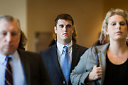 Former UW-Madison student Alec Cook arrives for his sentencing hearing at the Dane County Courthouse in Madison, Wisconsin, Thursday, June 21, 2018. Cook's attorneys Chris Van Wagner, left, and Jessa Nicholson Goetz, right.
