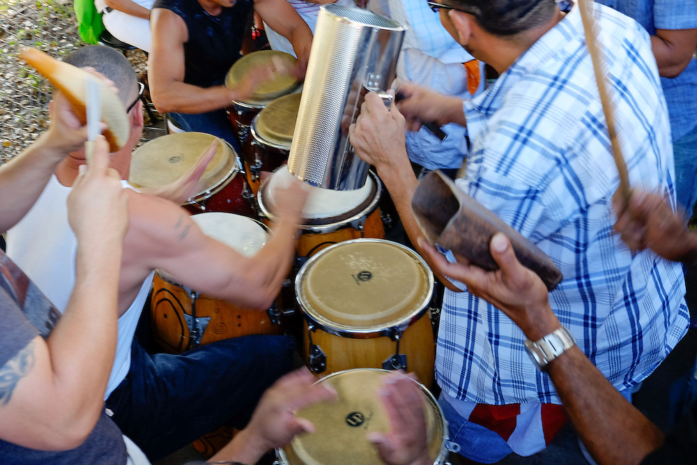 MIAMI - MARCH 9, 2014: Band playing music in the streets of calle 8 during the  37th Calle Ocho festival, an annual event that takes place over Eight Street in Little Havana featuring plenty of music, food, and  it is the biggest party in town that celebrates hispanic heritage.