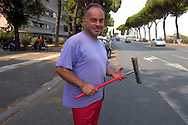 Roma 30 Agosto 2007.Paolo, italiano, lavora per strada come lavavetri delle automobili  a via del Circo Massimo, lavoro precario viene sempre mandato via dalla Polizia Municipale