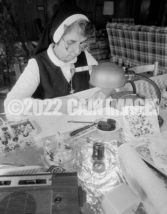 Sister Josaphat Slobodian places wax on an egg while doing her Ukrainian egg decorating, or pysanky, Tuesday, May 01, 1990 at Sisters of Saint Basil The Great motherhouse in Glenside, Pennsylvania. (Photo by William Thomas Cain/Cain Images)