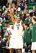 Dec 07, 2011; Birmingham, AL, USA;UAB Blazers guard Robert Williams (5) reacts after forward Jordan Swing (44) ( not Shown ) hit a 3 pointer late in the game against the Middle Tennessee Blue raiders at  Bartow Arena. The Blazers defeated the Blue Raiders 66-56Mandatory Credit: Marvin Gentry-