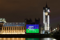 "© Licensed to London News Pictures. 06/02/2018. London, UK. A projection reading ""Deeds not words"" onto the Palace of Westminster by the Women's Equality Party to mark the centenary of the 1918 Representation of the People Act, which passed on 6 February 1918. Photo credit: Vickie Flores/LNP"