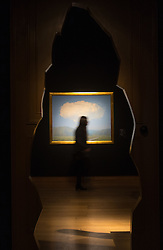 Christie's, London, February 24th 2017. Fine art auctioneers Christie's hold a press preview for their Impressionist and Modern Art and Art of the Surreal sale which takes place on 28th February. PICTURED: A woman passes René Magritte's La corde sensible (1960) valued between £14-18 million.