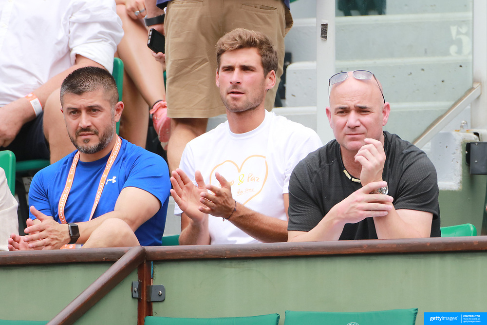 2017 French Open Tennis Tournament - Day Two. Coach Andre Agassi watching Novak Djokovic of Serbia in action against Marcel Granollers of Spain on Court Philippe-Chatrier during the Men's Singles Round one match at the 2017 French Open Tennis Tournament at Roland Garros on May 29th, 2017 in Paris, France.  (Photo by Tim Clayton/Corbis via Getty Images)