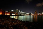 Manhattan, New York, USA, 20080312:   Brooklyn Bridge and Manhattan Financial district by night.<br /> <br /> <br /> <br /> Photo: Orjan F. Ellingvag