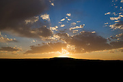 Sunset over a hill in the Montana prairie