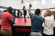 (L to R) UFC light heavyweight Jon Jones, UFC middleweight Derek Brunson and coach Mike Winkeljohn look on during sparing at Jackson Wink MMA in Albuquerque, New Mexico on June 9, 2016.