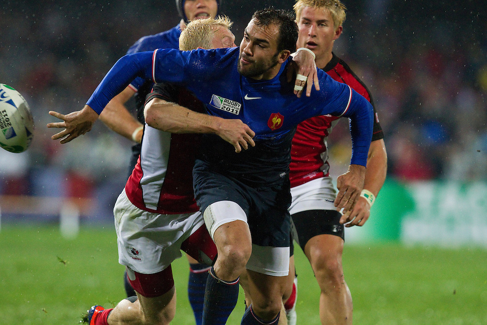 France's David Marty off loads the ball during a tackle at the pool A match against Canada, 2011 Rugby World Cup, McLean Park, Napier, New Zealand, Sunday September18, 2011.  Credit: SNPA / Bethelle McFedries