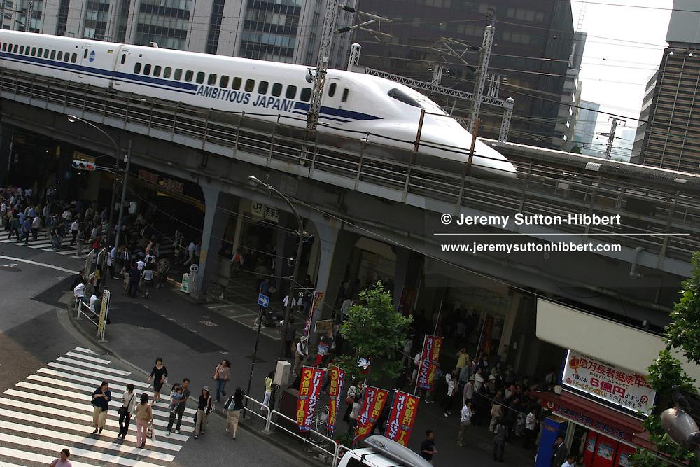 A bullet train cuts a swathe through the Yurakucho district of Tokyo, Japan.