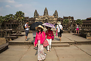 Two Asian female visitors walk away from Angkor Wat temple Angkor Wat Siem Reap, Cambodia.  Angkor Wat is Cambodia's main tourist destination.  (photo by Andrew Aitchison / In pictures via Getty Images)