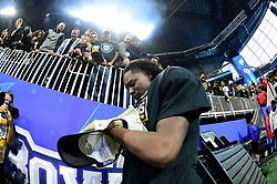 UCF Knights linebacker Shaquem Griffin signs autographs after the Chick-fil-A Peach Bowl NCAA college football game at the Mercedes-Benz Stadium in Atlanta, January 1, 2018. UCF won 34-27 to go undefeated for the season. (David Tulis via Abell Images for Chick-fil-A Peach Bowl)