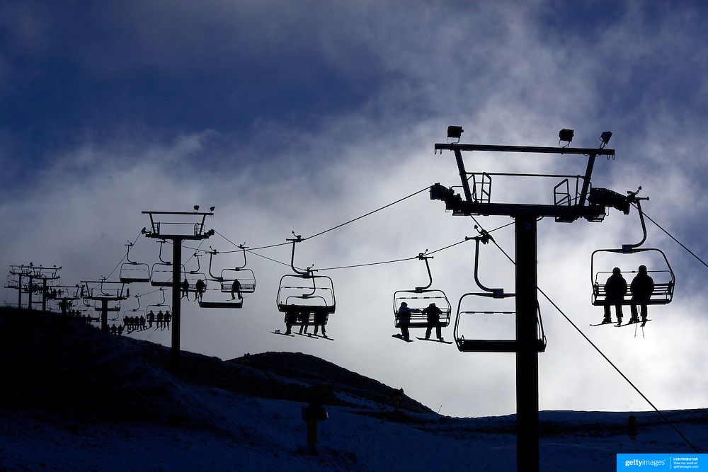 The ski lifts finally working at Coronet Peak as Skiers and snowboarders enjoy the opening day of the Ski season in Queenstown at Coronet Peak which  opened thanks to snow making machines. Coronet Peak, Queenstown,  South Island, New Zealand, 30th June 2011