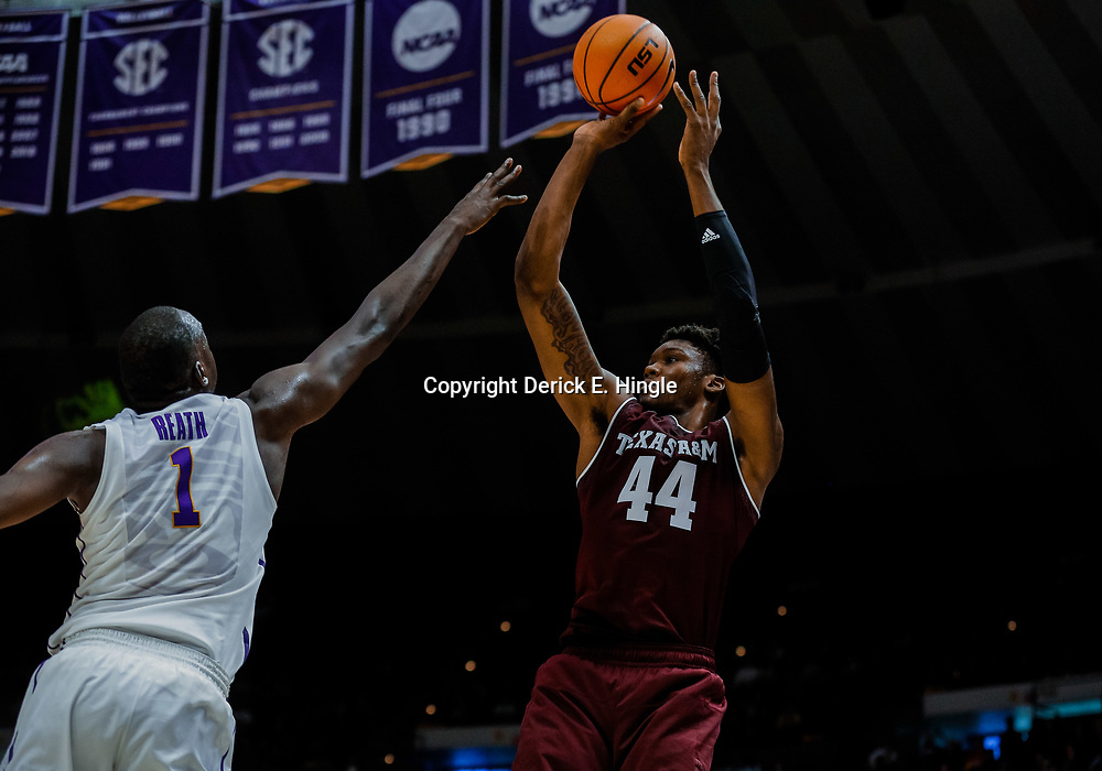 Jan 23, 2018; Baton Rouge, LA, USA; Texas A&M Aggies forward Robert Williams (44) shoots over LSU Tigers forward Duop Reath (1) during the first half at the Pete Maravich Assembly Center. Mandatory Credit: Derick E. Hingle-USA TODAY Sports