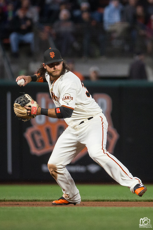 San Francisco Giants shortstop Brandon Crawford (35) fields a ground ball against the Pittsburgh Pirates at AT&T Park in San Francisco, California, on July 25, 2017. (Stan Olszewski/Special to S.F. Examiner)