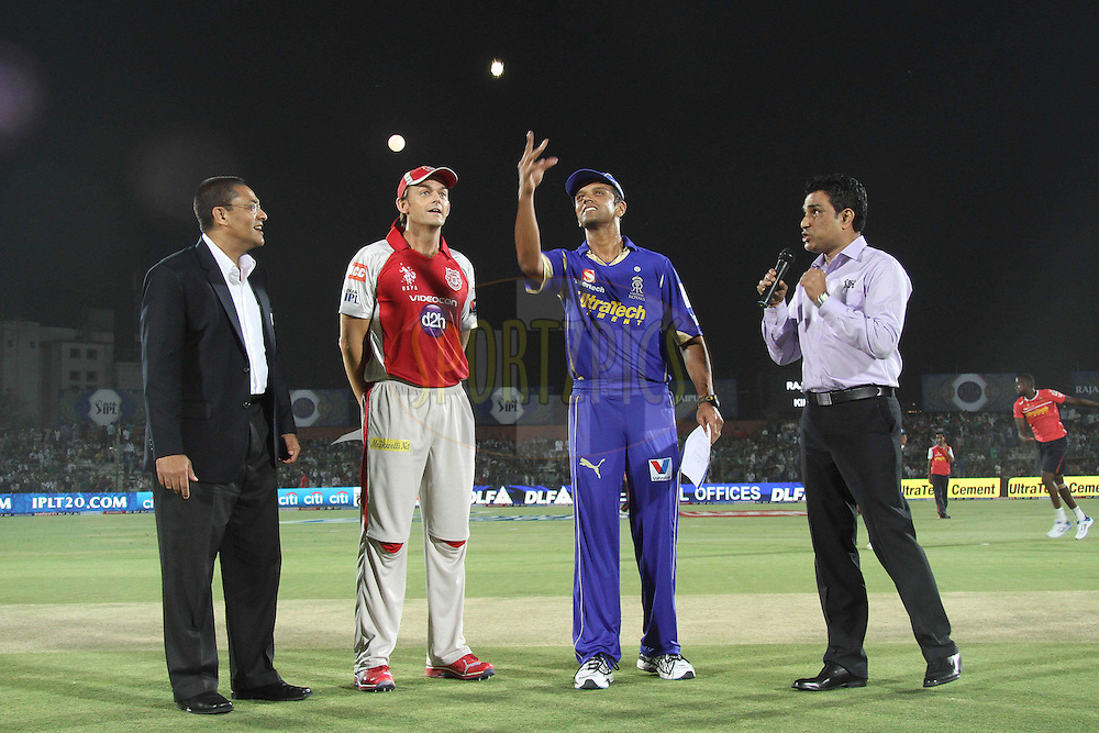 Kings XI Punjab captain Adam Gilchrist calls as Rajasthan Royals captain Rahul Dravid tosses the coin while Match Referee Ranjan Madugalle and commentator Sanjay Mandrekar look on during match 4 of the the Indian Premier League ( IPL) 2012  between The Rajasthan Royals and the Kings X1 Punjab held at the Sawai Mansingh Stadium in Jaipur on the 6th April 2012..Photo by Shaun Roy/IPL/SPORTZPICS