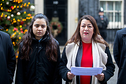 © Licensed to London News Pictures. 12/12/2017. London, UK. Bereaved residents from the Grenfell Tower tragedy Sandra Ruiz and a girl who does not want to be named speak to media after handing a petition in at Downing Street, calling for the public inquiry into the disaster to be overhauled. This includes having a panel from a diverse range of backgrounds installed alongside Sir Martin Moore-Bick, the retired Court of Appeal judge leading the process. Photo credit : Tom Nicholson/LNP