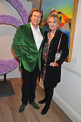THEO & LOUISE FENNELL at a reception to celebrate the publication of Candy and Candy: The Art of Design held at the Halcyon Gallery, 24 Bruton Street, London W1 on 26th October 2011.