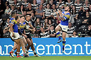 Leeds Rhinos winger Tom Briscoe (2) jumps and claims a high ball during the Betfred Super League match between Hull FC and Leeds Rhinos at Kingston Communications Stadium, Hull, United Kingdom on 19 April 2018. Picture by Mick Atkins.