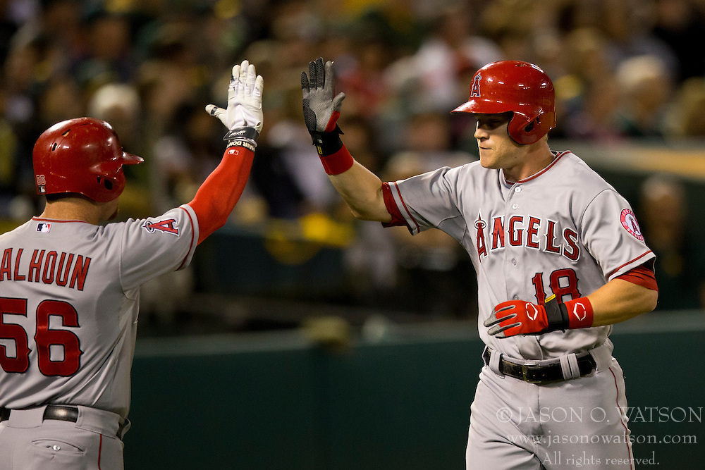 OAKLAND, CA - SEPTEMBER 23:  Gordon Beckham #18 of the Los Angeles Angels of Anaheim is congratulated by Kole Calhoun #56 after hitting a home run against the Oakland Athletics during the sixth inning at O.co Coliseum on September 23, 2014 in Oakland, California. The Los Angeles Angels of Anaheim defeated the Oakland Athletics 2-0.  (Photo by Jason O. Watson/Getty Images) *** Local Caption *** Gordon Beckham; Kole Calhoun