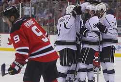May 30; Newark, NJ, USA; The Los Angeles Kings celebrate a goal during the first period of 2012 Stanley Cup Finals Game 1 at the Prudential Center.  The Kings defeated the Devils 2-1.