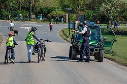 © Licensed to London News Pictures. 21/04/2020. London, UK. Police speak to a women on a bike where cycling and driving have been banned in the park since lockdown. Police patrol Richmond Park enforcing lockdown rules with a Police 4x4 buggy which is one of only four, originally built for the Olympics and now used during the pandemic in the Royal park for its off-road capabilities. Photo credit: Alex Lentati/LNP