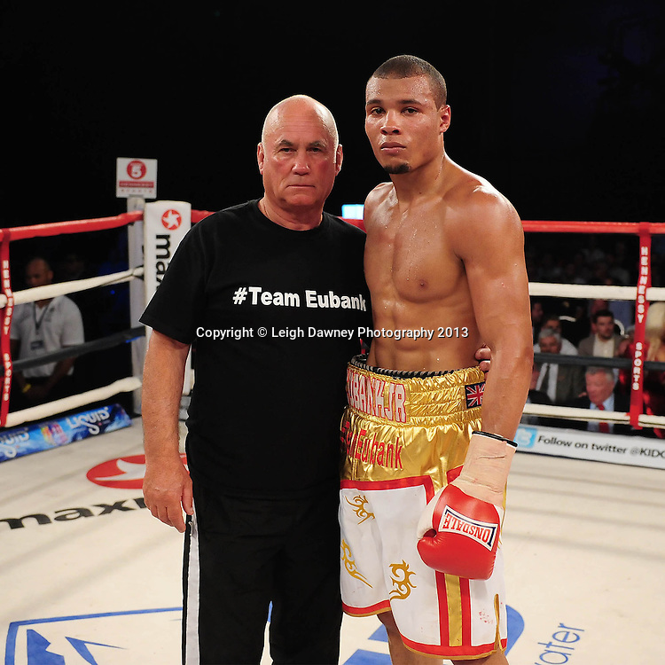 Chris Eubank Jnr and trainer pose for photo after he defeated Tyan Booth in a Middleweight contest at Glow, Bluewater, Dartford, Kent, UK on 8th June 2013. Promoter: Hennessy Sports. Mandatory Credit: © Leigh Dawney