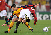 Robin Van Persie and Francesco Totti clash during the UEFA Champions League, Round of Last 16, Second Leg match between AS Roma and Arsenal at the Stadio Olimpico on March 11, 2009 in Rome, Italy.