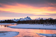 Sunset of the Gand Tetons as the light of the sky is sucked up like a magnet by the Snake River below.<br />