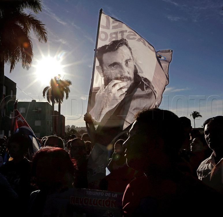 Cubans gather along the road as they wait for the caravan carrying the ashes of Cuban leader Fidel Castro on the way to to Santa Ifigenia cemetery, Castro's final resting place, in Santiago de Cuba on Sunday, December 4, 2016.