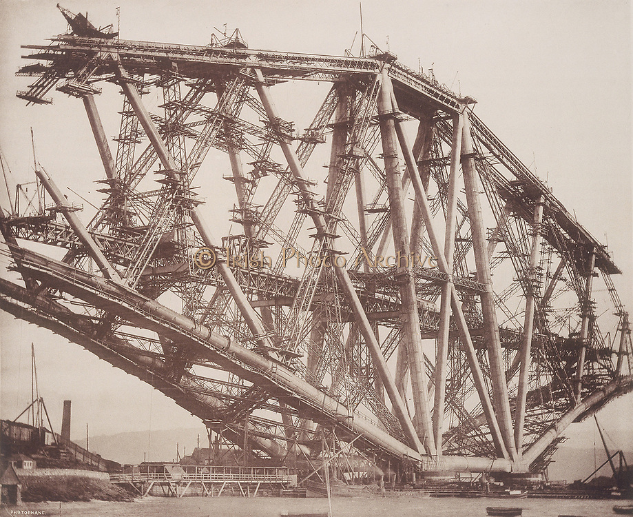 Forth Railway Bridge, Scotland: the Fife cantilever under construction during October 1888. This was the first steel bridge, and was built with tubes fabricated from sheet steel produced by the Siemens-Martin process. It carried the railway across the Firth of Forth near Edinburgh. Designed by the British civil engineers John Fowler (1817-1898) and Benjamin Baker (1840-1907). Opened in 1890.  Photograph.