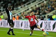 Allan Saint-Maximin (#10) of Newcastle United looks on as Cedric Soares (#2) of Southampton keeps the ball in play during the Premier League match between Newcastle United and Southampton at St. James's Park, Newcastle, England on 8 December 2019.