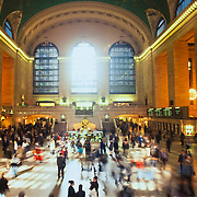 Rush hour in the lobby of Grand Central station with commuters racing off their appointed destinations.