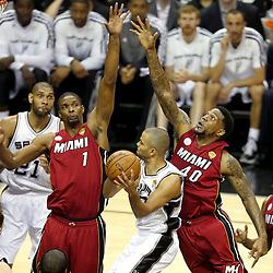 Jun 11, 2013; San Antonio, TX, USA; San Antonio Spurs point guard Tony Parker (9) drives to the basket as he is defended by Miami Heat power forward Udonis Haslem (40)and Chris Bosh (1) in the first quarter during game three of the 2013 NBA Finals at the AT&T Center. Mandatory Credit: Derick E. Hingle-USA TODAY Sports