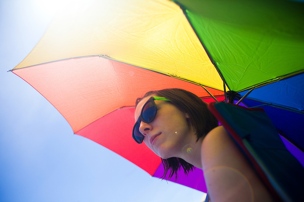 Julia Dilger enjoys the shade of an umbrella while watching the bands at The Nateva Music and Camping Festival in Oxford, Maine over the 4th of July Weekend 2010.