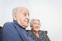 ACCIAROLI (POLLICA), ITALY - 5 OCTOBER 2016: (L-R) 100-years-old Antonio Vassallo and his 93-years-old wife Amina Fedullo are here in their home in Acciaroli, a hamlet in the municipality of Pollica, Italy, on October 5th 2016. Mrs Fedullo was a farmer her entire life, while Mr Vassallo was a soldier in Italy's military forces in the Italian East Africa, the Italian colony in the Horn of Africa. They've been married for 66 years.<br /> <br /> To understand how people can live longer throughout the world, researchers at University of California, San Diego School of Medicine have teamed up with colleagues at University of Rome La Sapienza to study a group of 300 citizens, all over 100 years old, living in Acciaroli (Pollica), a remote Italian village nestled between the ocean and mountains in Cilento, southern Italy.<br /> <br /> About 1-in-60 of the area's inhabitants are older than 90, according to the researchers. Such a concentration rivals that of other so-called blue zones, like Sardinia and Okinawa, which have unusually large percentages of very old people. In the 2010 census, about 1-in-163 Americans were 90 or older.