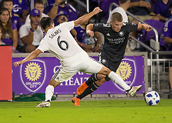 April 21, 2018 - Orlando, FL, U.S. - ORLANDO, FL - APRIL 21: Orlando City forward Chris Mueller (17) gets fouled by San Jose Earthquakes midfielder Shea Salinas (6) during the MLS soccer match between the Orlando City FC and the San Jose Earthquakes at Orlando City SC on April 21, 2018 at Orlando City Stadium in Orlando, FL. (Photo by Andrew Bershaw/Icon Sportswire) (Credit Image: © Andrew Bershaw/Icon SMI via ZUMA Press)