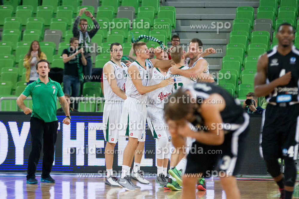Players of KK Union Olimpija celebrate during basketball match between KK Union Olimpija Ljubljana and Dolomiti Energia Trento (ITA) in Round #1 of EuroCup 2015/16, on October 14, 2015 in Arena Stozice, Ljubljana, Slovenia. Photo by Urban Urbanc / Sportida
