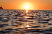 Sunrise in dramatic orange sky over mediterranean sea, Benidorm, Costa Blanca, Alicante province, Spain