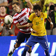 Neymar, Brazil, (right) challenges Steve Cherundolo, USA, during the USA V Brazil International friendly soccer match at FedEx Field, Washington DC, USA. 30th May 2012. Photo Tim Clayton