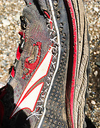 A bit of trail surgery was performed on this shoe, which had made it more than 750 miles from the desert to the Sierra Nevada before getting blown out. Still needing shoes to make it to the next resupply point, the hole was sewed up using dental floss. Thru-hikers will opt to wear trail running shoes, which are lighter and dry faster than traditional hiking boots. It's not uncommon for a thru-hiker to wear out many pairs of shoes on their journey to Canada.