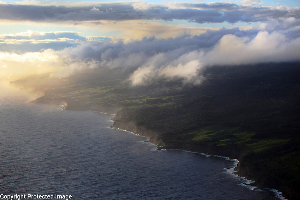 "An aerial view of the Kohala coast where many of Hawaii's ranches are located.  Some of the best ranchland, however, is up country at 3,000 feet and higher where winds can blow at 60 miles an hour or more and temperatures can drop into the low 40's.  ""We'd get up, like 2:30 in the morning, saddle the horses.  It would be pouring rain and wind and cold but we loved the lifetyle. That was our love,"" says Sonny Keakealani, reflecting back on his years working as a cowboy.  Today he takes care of  a small ranch along the Kohala coast."