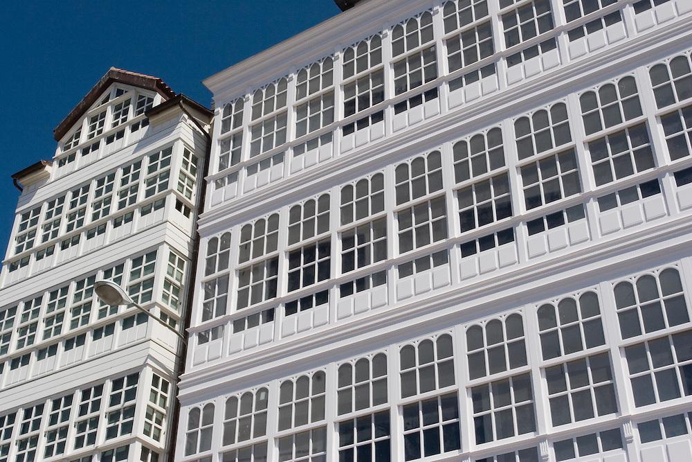 One of the largest glass constructions in the world and one fo the city&acute;s most emblematic images lies on the windowed balconies of the buildings in Avenida de La Marina. <br /> Galer&iacute;as  en el t&iacute;pico &quot;coru&ntilde;&eacute;s&quot;, en la fachada de los edifiicios orientados a la d&aacute;rsena, en La Coru&ntilde;a.