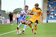 Colchester Utd defender Richard Brindley and Cambridge Utd defender Greg Taylor clash during the EFL Sky Bet League 2 match between Colchester United and Cambridge United at the Weston Homes Community Stadium, Colchester, England on 13 August 2016. Photo by Nigel Cole.