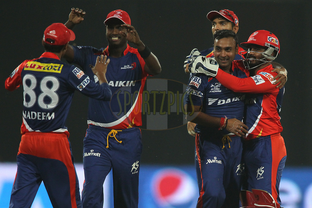 Shahbaz Nadeem of the Delhi Daredevils is congratulated by Angelo Mathews of the Delhi Daredevils and Amit Mishra of the Delhi Daredevils is congratulated by Kedar Jadhav of the Delhi Daredevils for getting Kieron Pollard of Mumbai Indians wicket during match 21 of the Pepsi IPL 2015 (Indian Premier League) between The Delhi Daredevils and The Mumbai Indians held at the Ferozeshah Kotla stadium in Delhi, India on the 23rd April 2015.<br /> <br /> Photo by:  Shaun Roy / SPORTZPICS / IPL