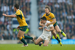 England Outside Centre Brad Barritt is tackled by Australia Winger Rob Horne - Photo mandatory by-line: Rogan Thomson/JMP - 07966 386802 - 29/11/2014 - SPORT - RUGBY UNION - London, England - Twickenham Stadium - England v Australia - QBE Autumn Internationals.