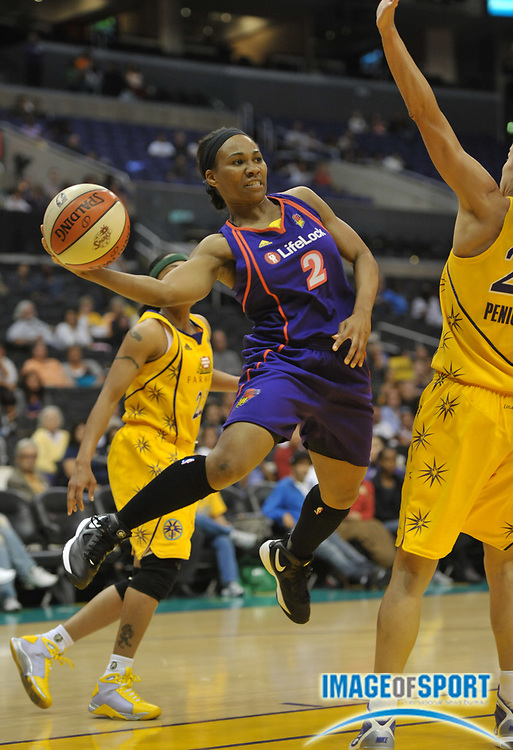 Jun 8, 2010; Los Angeles, CA, USA; Phoenix Mercury guard Temeka Johnson (2) passes the ball during the game against the Los Angeles Sparks at the Staples Center. The Sparks defeated the Mercury 92-91.