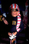 Boy age 6 trick or treating in pirate costume on Halloween night.  St Paul  Minnesota USA